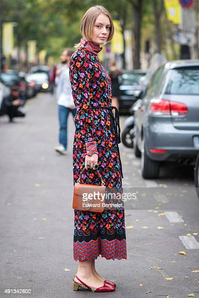 Alina Gelzina wearing a vintage dress and Gucci bag after the John Galliano show during the Paris Fashion Week SS16 on October 4 2015 in Paris France