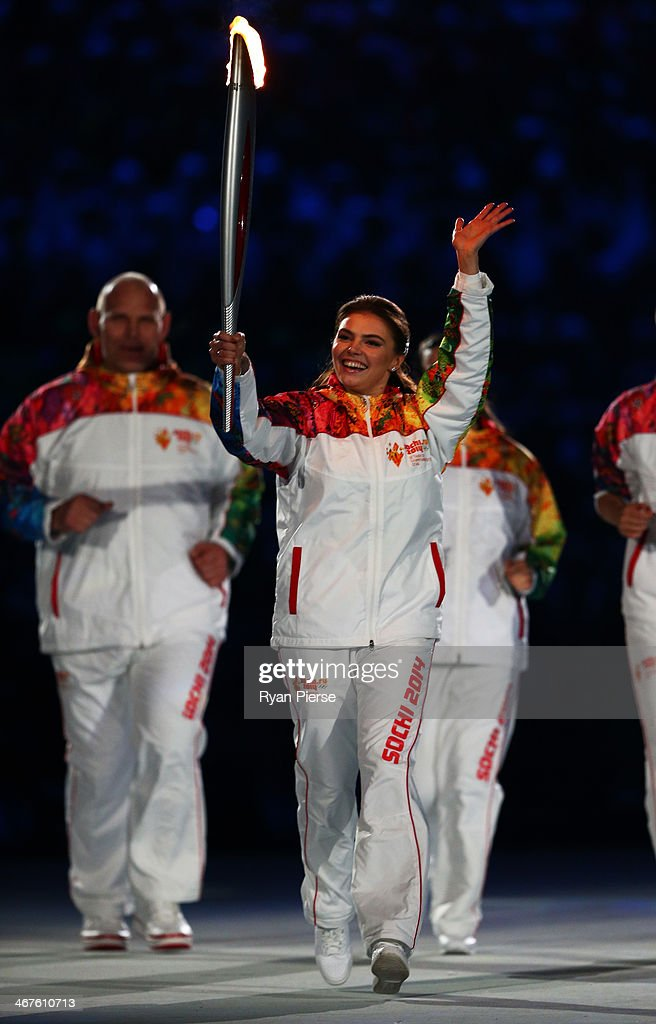 <a gi-track='captionPersonalityLinkClicked' href=/galleries/search?phrase=Alina+Kabaeva&family=editorial&specificpeople=633246 ng-click='$event.stopPropagation()'>Alina Kabaeva</a> carries the Olympic torch into the stadium during the Opening Ceremony of the Sochi 2014 Winter Olympics at Fisht Olympic Stadium on February 7, 2014 in Sochi, Russia.