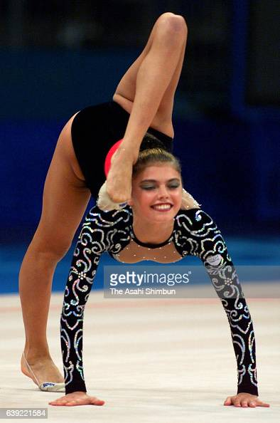 Vladimir Putin Alina-kabaeva-of-russia-competes-in-the-ball-during-the-rhythmic-picture-id639221584?s=594x594