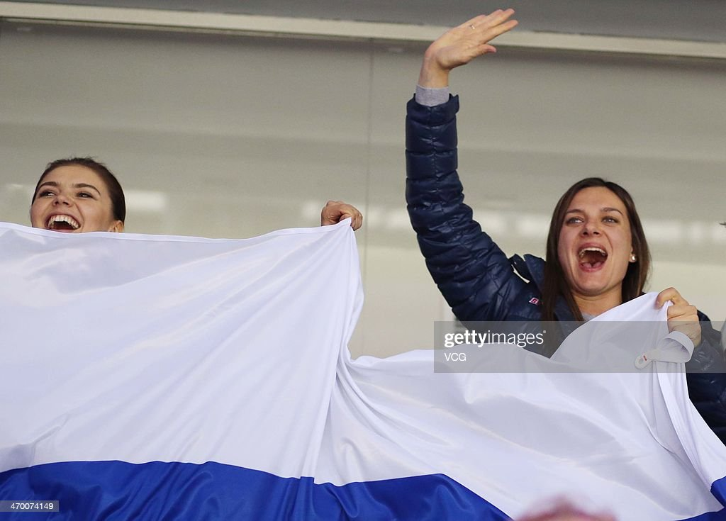 <a gi-track='captionPersonalityLinkClicked' href=/galleries/search?phrase=Alina+Kabaeva&family=editorial&specificpeople=633246 ng-click='$event.stopPropagation()'>Alina Kabaeva</a> (L), Russian Olympic champion in rhythmic gymnastics and Yelena Isinbayeva (R), Russian double Olympic pole vault champion watch the men's Preliminary Round Group A ice hockey match Russia vs Slovakia at Bolshoi Ice Palace at the 22nd Winter Olympic Games on February 16, 2014 in Sochi, Russia.