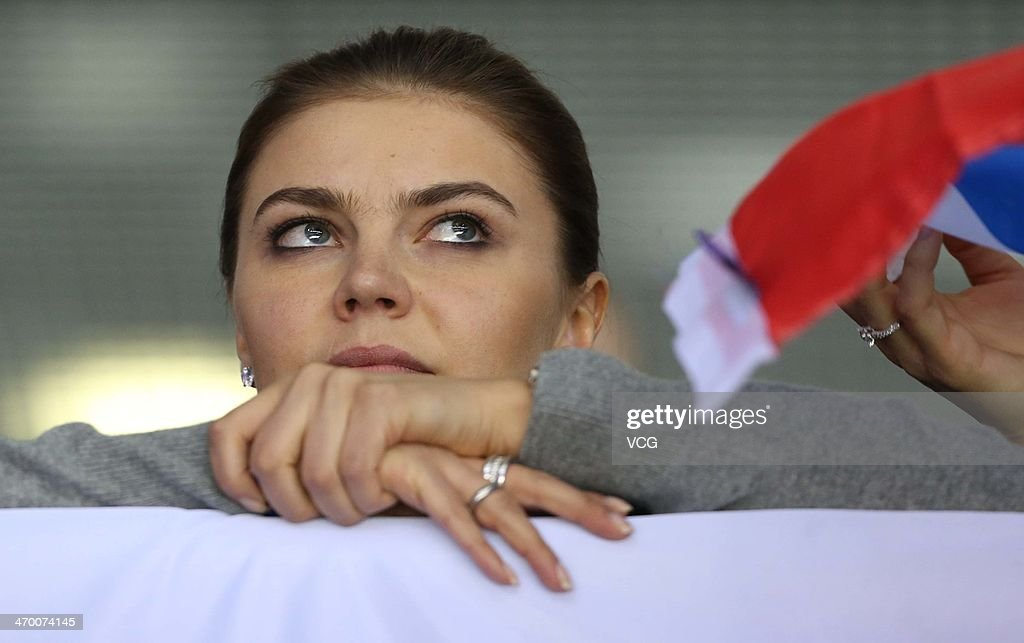 <a gi-track='captionPersonalityLinkClicked' href=/galleries/search?phrase=Alina+Kabaeva&family=editorial&specificpeople=633246 ng-click='$event.stopPropagation()'>Alina Kabaeva</a>, Russian Olympic champion in rhythmic gymnastics watches the men's Preliminary Round Group A ice hockey match Russia vs Slovakia at Bolshoi Ice Palace at the 22nd Winter Olympic Games on February 16, 2014 in Sochi, Russia.