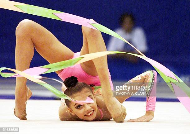 Alina Kabayeva of Russia performs part of her gold medal winning routine with the ribbon during the rhythmic gymnastic individual exercise final...