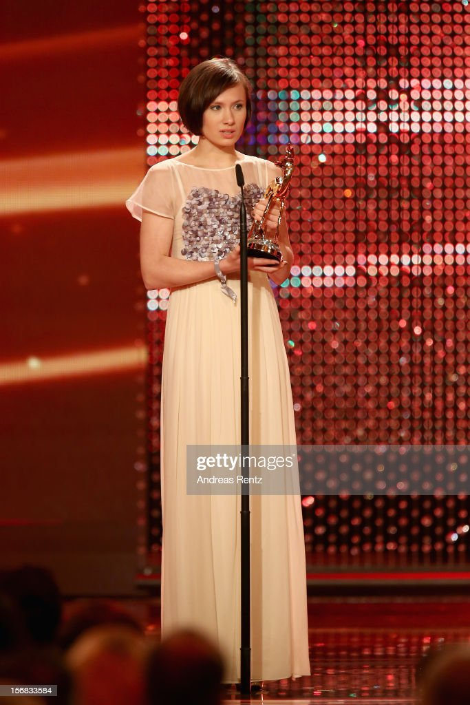 Alina Levshin receives the Bambi award during the 'BAMBI Awards 2012' at the Stadthalle Duesseldorf on November 22, 2012 in Duesseldorf, Germany.