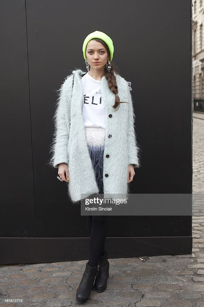 Alina Portnova student wearing H&M Jackket, Top Shop hat and jewelry, Zara dress Chenel bag, 69 shoes, on day 2 of London Womens Fashion Week Autumn/Winter 2013 on February 16, 2013 in London, England.