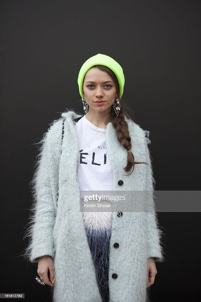 Alina Portnova student wearing H&M Jackket, Top Shop hat and jewelry, Zara dress, on day 2 of London Womens Fashion Week Autumn/Winter 2013 on February 16, 2013 in London, England.
