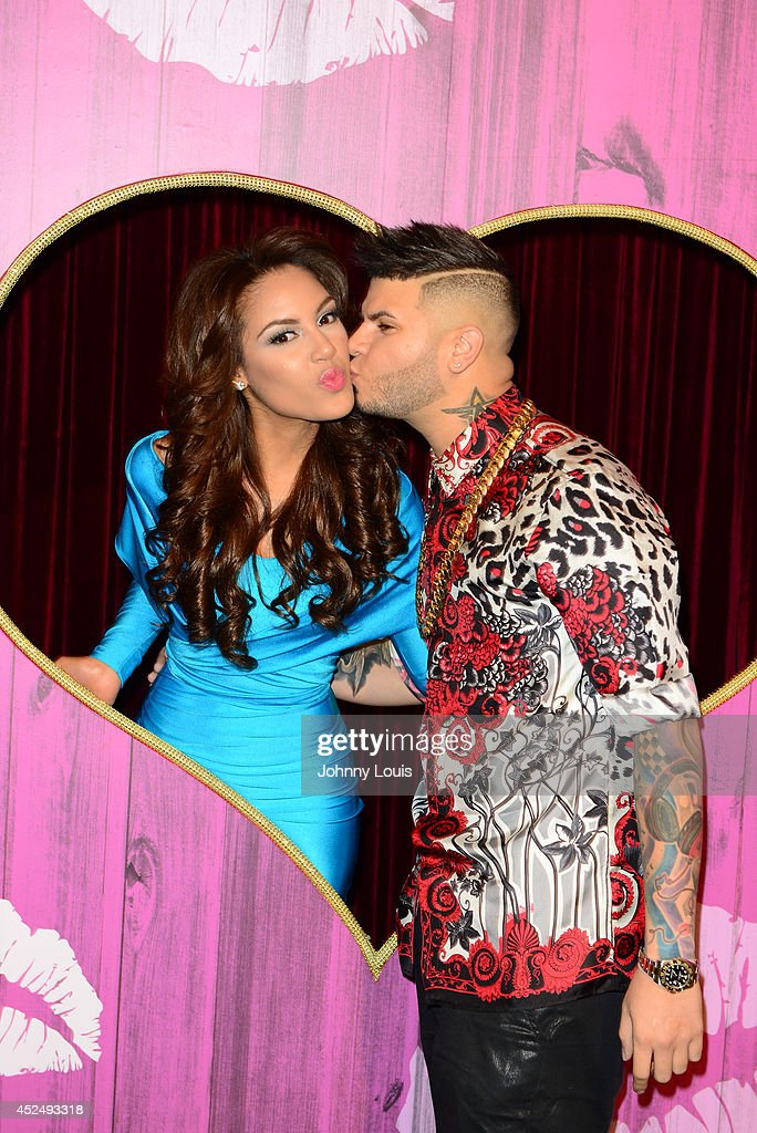 Alina Robert and <a gi-track='captionPersonalityLinkClicked' href=/galleries/search?phrase=Farruko&family=editorial&specificpeople=11714143 ng-click='$event.stopPropagation()'>Farruko</a> attend the Premios Juventud 2014 Awards at Bank United Center on July 17, 2014 in Miami, Florida.