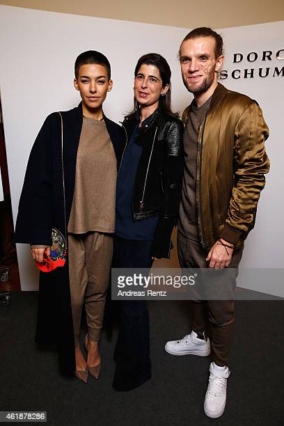 Alina Sueggeler Dorothee Schumacher and Andreas Weizel pose backstage after the Dorothee Schumacher show during the MercedesBenz Fashion Week Berlin...