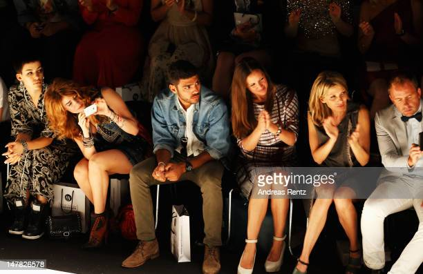 Alina Sueggeler Palina Rojinski Noah Becker Dana Schweiger and Ursula Karven sit in front row during the Designer For Tomorrow show at the...