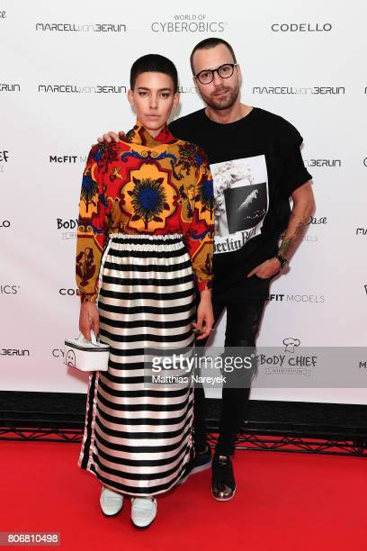 Alina Sueggler and designer Marcell von Berlin are seen during the Marcell von Berlin 'Genesis' collection presentation on July 3 2017 in Berlin...