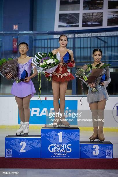 Alina Zagitova of Russia Kaori Sakamoto and Rin Nitaya of Japan pose for a photo after the junior ladies free skating on day two of the ISU Junior...