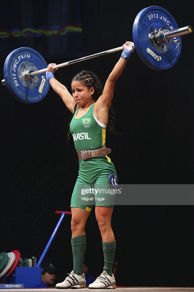 Aline Ferreira of Brazil competes in women's 53 kg as part of the I ODESUR South American Youth Games at Coliseo Miguel Grau on September 27, 2013 in Lima, Peru.