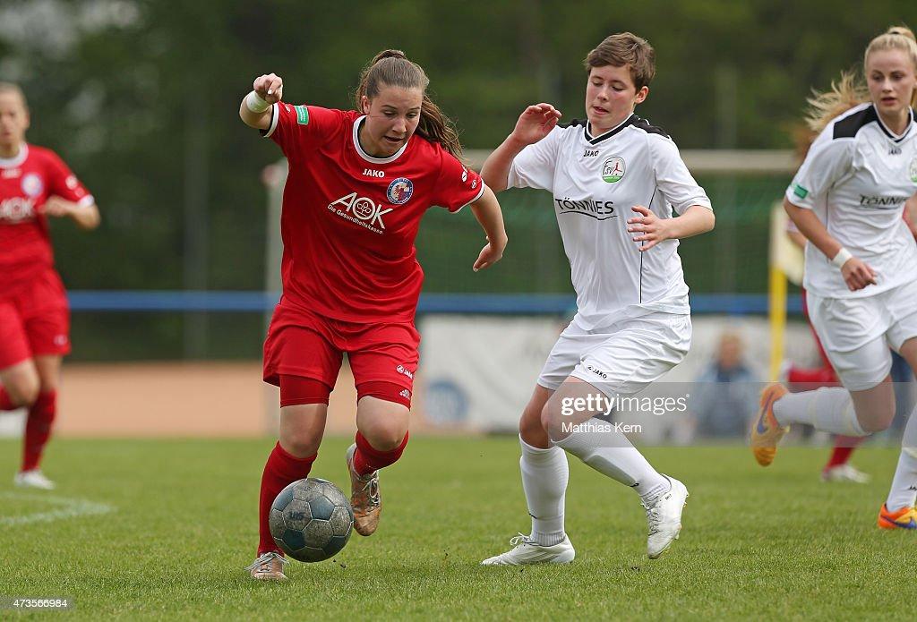 Aline Reinkober of Potsdam battles for the ball with Svenja Hoerenbaum of Guetersloh during the U17 Girl's Bundesliga semi final first leg match...