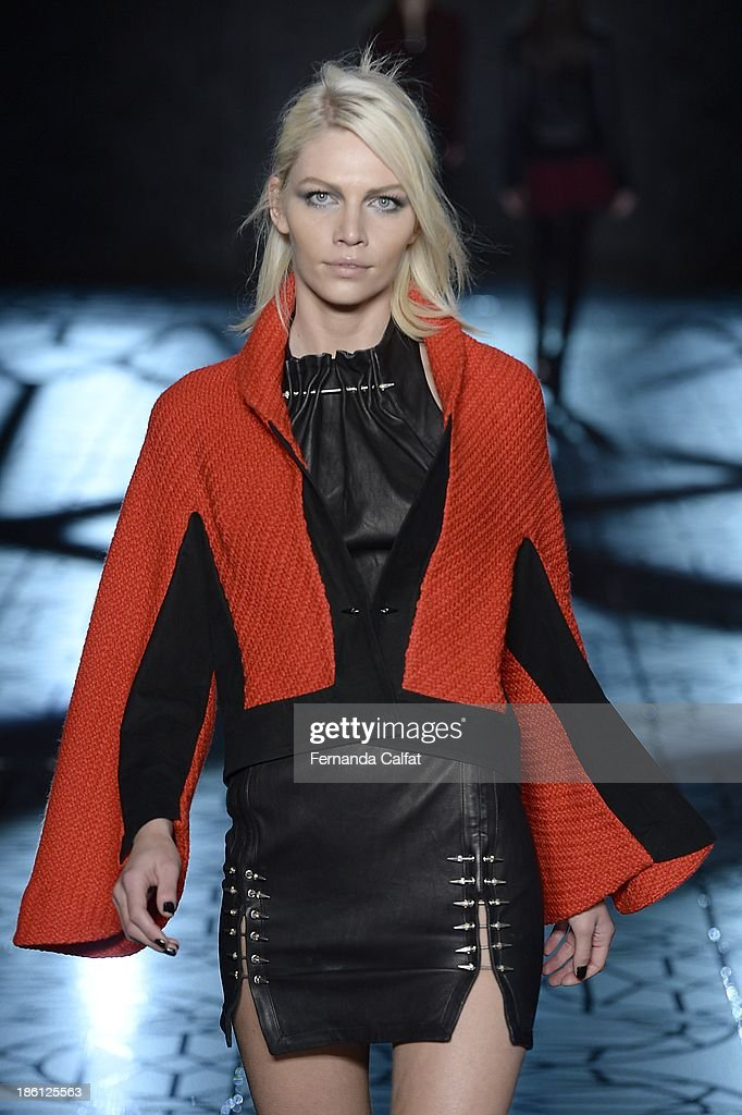 Aline Weber walks the runway during Animale show at Sao Paulo Fashion Week Winter 2014 on October 28, 2013 in Sao Paulo, Brazil.