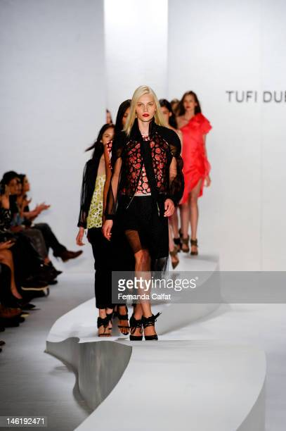 Aline Weber walks the runway during the Tufi Duek show during Sao Paulo Fashion Week Spring/Summer 2013 Collections on June 11 2012 in Sao Paulo...