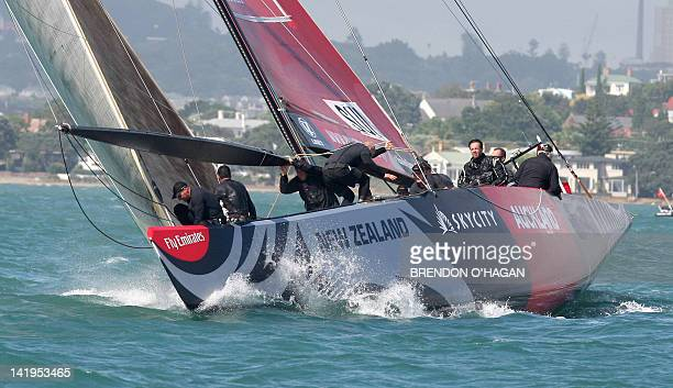 Alinghi from Swizerland prepares to round the mark ahead of Oracle Racing of the US in the final of the Challenger series in Auckland on February 12...