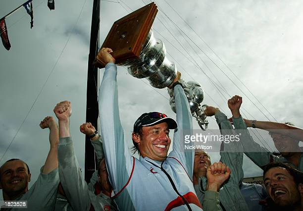 Alinghi Syndicate head Ernesto Bertarelli lifts the America's Cup after Race Five of the America's Cup between Team New Zealand and Alinghi of...