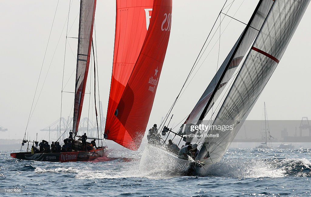 Alinghi Team Switzerland trails behind Emirates Team New Zealand at the first turn race during the third race of the 32nd America's Cup Match by...