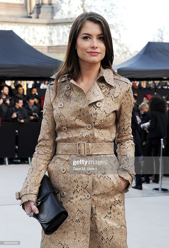 Alinne Moraes arrives at the Burberry Prorsum 2013 Autumn Winter Womenswear Show at Kensington Gardens on February 18, 2013 in London, England.