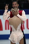 Aliona Savchenko and Robin Szolkowy of Germany celebrate after finishing their routine in the Pairs Free Program during ISU World Figure Skating...