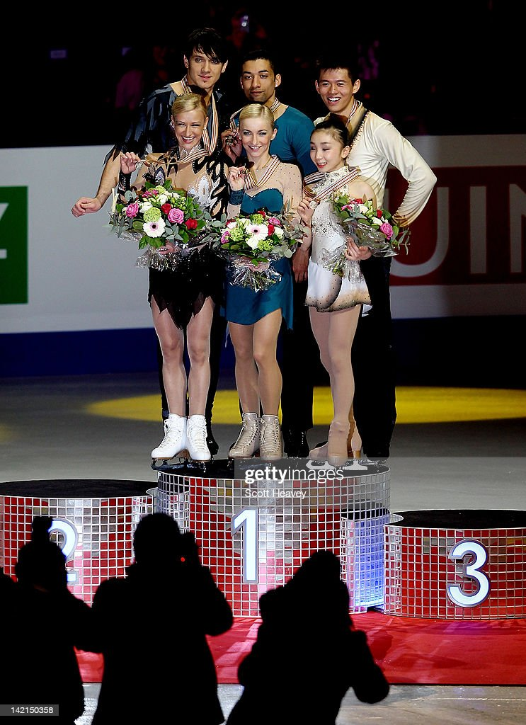 Aliona Savchenko and Robin Szolkowy of Germany (C) celebrate winning Gold with Vera Bazarova and Yuri Larionov of Russia winning Silver (L) and Narumi Takahashi and Mervin Tran winning Bronze (R) during day five of the ISU World Figure Skating Championships on March 30, 2012 in Nice, France.