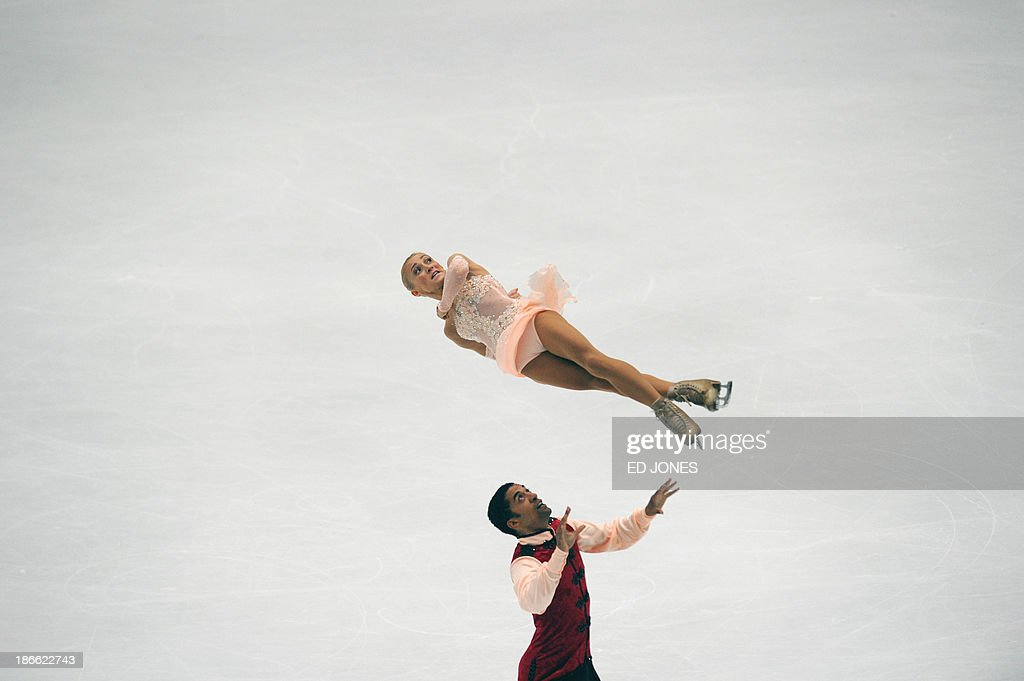 Aliona Savchenko and Robin Szolkowy of Germany compete during the Pairs Free Skating event of the Cup of China ISU Grand Prix Figure Skating in Beijing on November 2, 2013. Savchenko and Szolkowy finished with a score of 201.21 for 1st place.