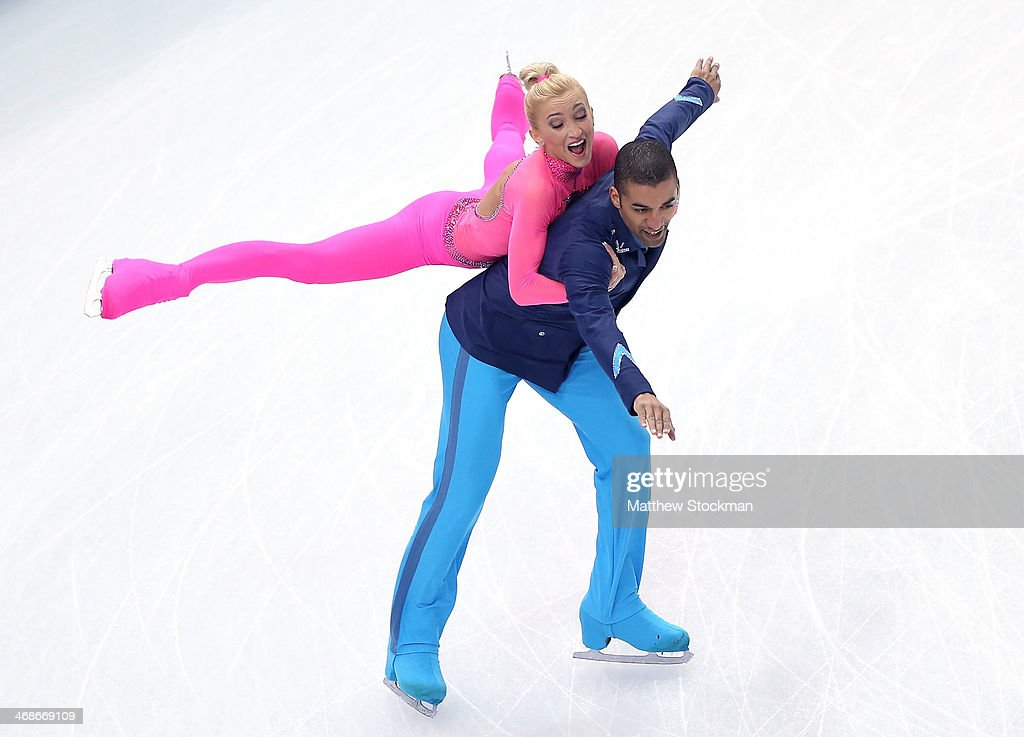 <a gi-track='captionPersonalityLinkClicked' href=/galleries/search?phrase=Aliona+Savchenko&family=editorial&specificpeople=247200 ng-click='$event.stopPropagation()'>Aliona Savchenko</a> and <a gi-track='captionPersonalityLinkClicked' href=/galleries/search?phrase=Robin+Szolkowy&family=editorial&specificpeople=247243 ng-click='$event.stopPropagation()'>Robin Szolkowy</a> of Germany compete during the Figure Skating Pairs Short Program on day four of the Sochi 2014 Winter Olympics at Iceberg Skating Palace on February 11, 2014 in Sochi, Russia.