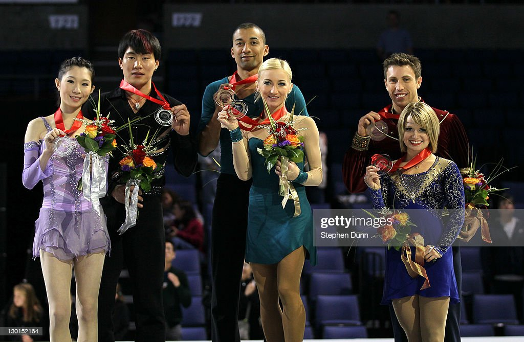 <a gi-track='captionPersonalityLinkClicked' href=/galleries/search?phrase=Aliona+Savchenko&family=editorial&specificpeople=247200 ng-click='$event.stopPropagation()'>Aliona Savchenko</a> and <a gi-track='captionPersonalityLinkClicked' href=/galleries/search?phrase=Robin+Szolkowy&family=editorial&specificpeople=247243 ng-click='$event.stopPropagation()'>Robin Szolkowy</a> of Germany (gold, center), Dan Zhang and Hao Zhang of China (silver, left) and Kirsten Moore-Towers and Dylan Moscovitch of Canada (bronze, right) hold up their gold medals after winning the Pairs competiton during Hilton HHonors Skate America at Citizens Business Bank Arena on October 23, 2011 in Ontario, California.