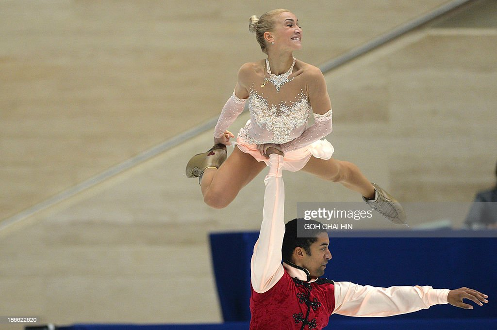 Aliona Savchenko (top) and Robin Szolkowy of Germany perform during their pairs free skating event of the Cup of China ISU Grand Prix of Figure Skating in Beijing on November 2, 2013. Savchenko and Szolkowy won the first place with a score of 201.21.