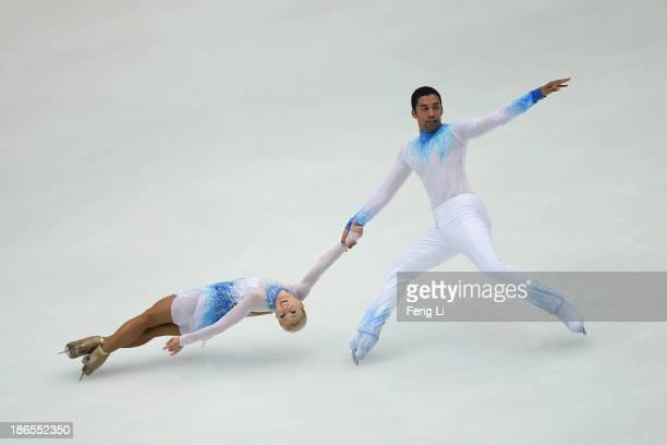 Aliona Savchenko and Robin Szolkowy of Germany skate in the Pairs Short Program during Lexus Cup of China ISU Grand Prix of Figure Skating 2013 at...