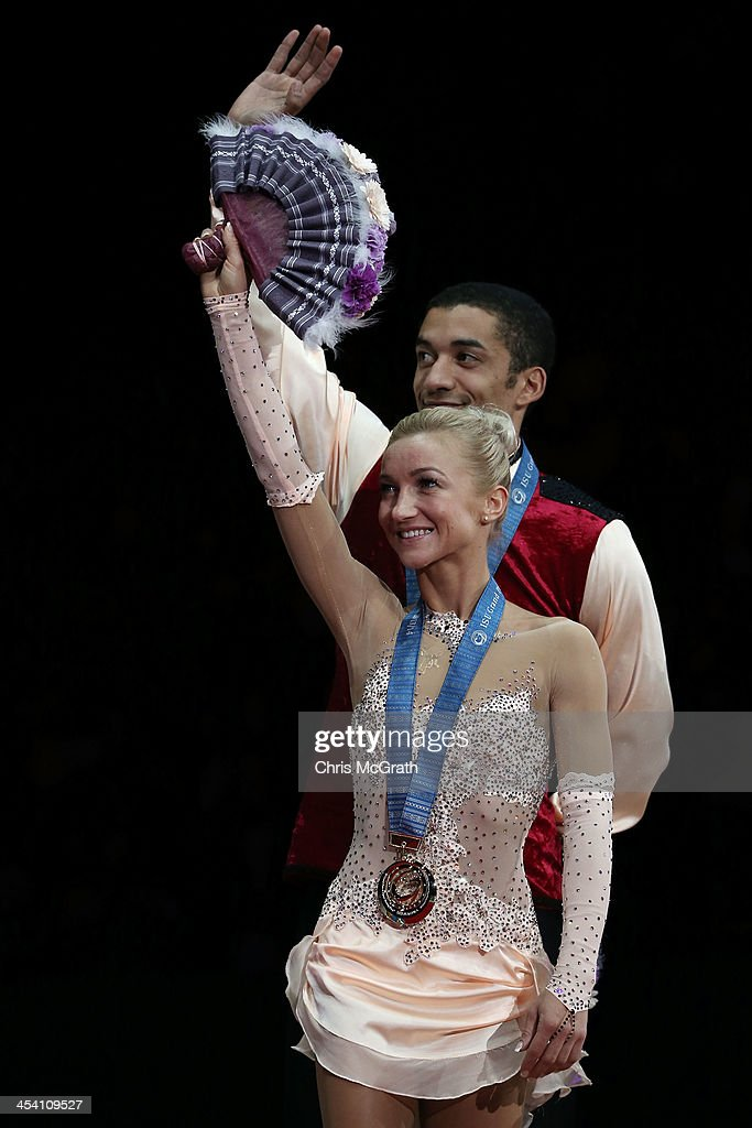 <a gi-track='captionPersonalityLinkClicked' href=/galleries/search?phrase=Aliona+Savchenko&family=editorial&specificpeople=247200 ng-click='$event.stopPropagation()'>Aliona Savchenko</a> and <a gi-track='captionPersonalityLinkClicked' href=/galleries/search?phrase=Robin+Szolkowy&family=editorial&specificpeople=247243 ng-click='$event.stopPropagation()'>Robin Szolkowy</a> of Germany wave to the crowd during the Pairs Free Skating Final victory ceremony on day three of the ISU Grand Prix of Figure Skating Final 2013/2014 at Marine Messe Fukuoka on December 7, 2013 in Fukuoka, Japan.