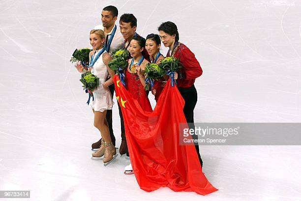 Aliona Savchenko and Robin Szolkowy of Germany win the bronze medal Hongbo Zhao and Xue Shen of China win the gold medal and Qing Pang and Jian Tong...