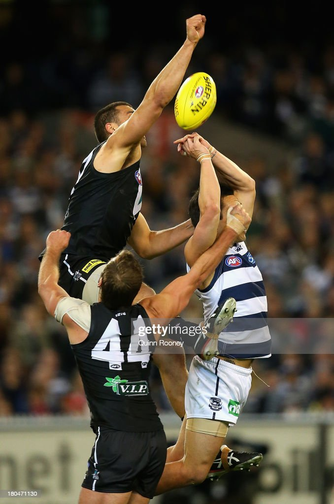 Alipate Carlile of the Power spoils a mark by Mathew Stokes of the Cats during the Second Semi Final match between the Geelong Cats and the Port Adelaide Power at Melbourne Cricket Ground on September 13, 2013 in Melbourne, Australia.