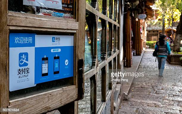 Alipay's poster is pasted on the window of an old family inn in Lijiang ancient town Alibabas Alipay mobile payments service has a 70% market share...