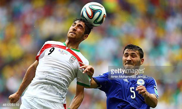 Alireza Jahan Bakhsh of Iran and Sead Kolasinac of Bosnia in action during the 2014 FIFA World Cup Brazil Group F match between Bosnia and...
