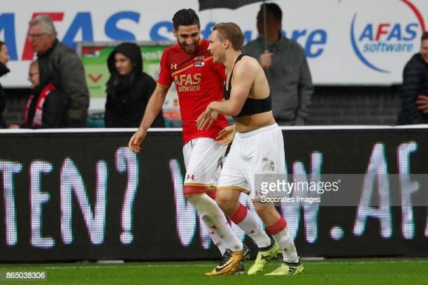 Alireza Jahanbakhsh of AZ Alkmaar Jonas Svensson of AZ Alkmaar celebrate victory during the Dutch Eredivisie match between AZ Alkmaar v FC Utrecht at...