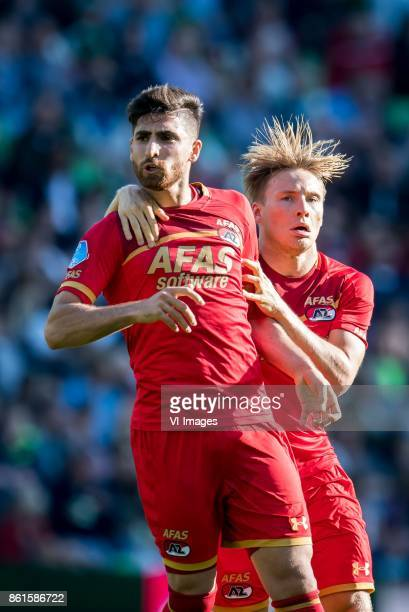 Alireza Jahanbakhsh of AZ Jonas Svensson of AZ 01 during the Dutch Eredivisie match between FC Groningen and AZ Alkmaar at Noordlease stadium on...