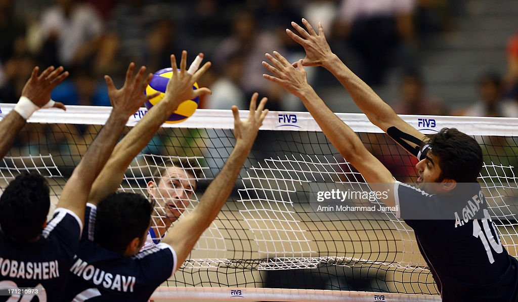 Alireza Mobasheri, Seyed Mohammad Mousavi Eraghi and Mehdi Mahdavi of Iran in action during the Volleyball World League match between Iran and Serbia on June 23, 2013 in Tehran, Iran Azadi Complex.