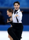 Alisa Agafonova and Alper Ucar of Turkey compete during the Figure Skating Ice Dance Short Dance on day 9 of the Sochi 2014 Winter Olympics at...