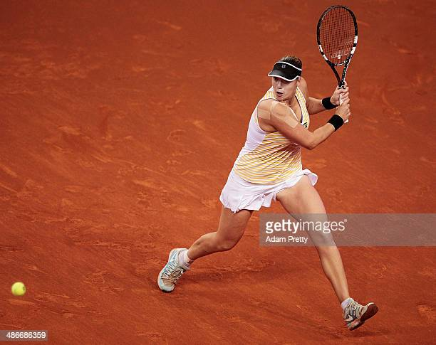 Alisa Kleybanova of Russia hits a backhand during her match against Jelena Jankovic of Serbia on day five of the Porsche Tennis Grand Prix at Porsche...