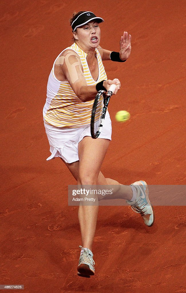 <a gi-track='captionPersonalityLinkClicked' href=/galleries/search?phrase=Alisa+Kleybanova&family=editorial&specificpeople=759744 ng-click='$event.stopPropagation()'>Alisa Kleybanova</a> of Russia hits a forehand during her match against Petra Kvitova of the Czech Republic during day 3 of the Porsche Tennis Grand Prix 2014 at Porsche-Arena on April 23, 2014 in Stuttgart, Germany.
