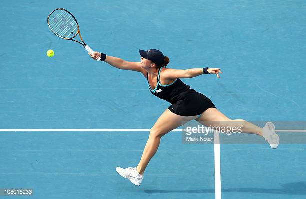 Alisa Kleybanova of Russia hits a forehand in her match against Kim Clijsters of Belgium during day five of the 2011 Medibank International at Sydney...