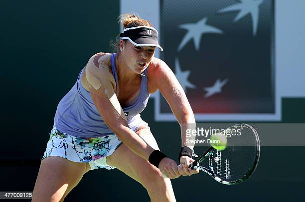 Alisa Kleybanova of Russia hits a return to Victoria Duval during the BNP Paribas Open at Indian Wells Tennis Garden on March 6 2014 in Indian Wells...