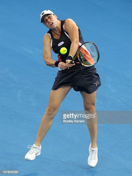 Alisa Kleybanova of Russia plays a backhand during her first round match against Sally Peers of Australia during day one of the Brisbane...
