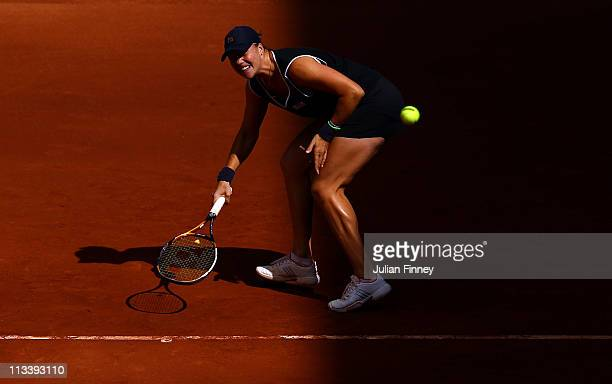 Alisa Kleybanova of Russia plays a forehand to Shanhar Peer of Israel during day three of the Mutua Madrilena Madrid Open Tennis on May 2 2011 in...