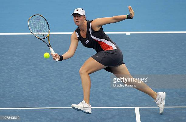 Alisa Kleybanova of Russia plays a forehand volley during her first round match against Sally Peers of Australia during day one of the Brisbane...