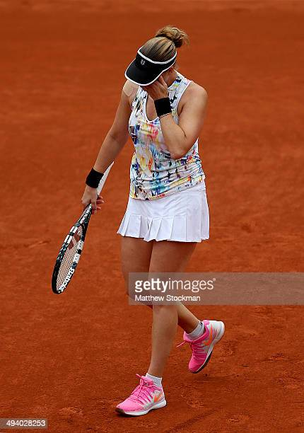 Alisa Kleybanova of Russia reacts during her women's singles match against Simona Halep of Romania on day three of the French Open at Roland Garros...
