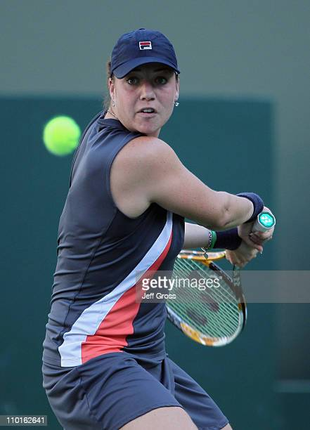 Alisa Kleybanova of Russia returns a backhand to Caroline Wozniacki of Denmark during the BNP Paribas Open at the Indian Wells Tennis Garden on March...