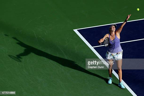 Alisa Kleybanova of Russia serves to Victoria Duval during the BNP Paribas Open at Indian Wells Tennis Garden on March 6 2014 in Indian Wells...