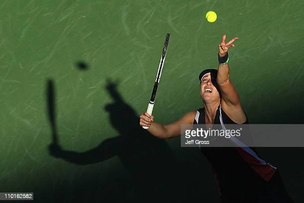 Alisa Kleybanova of Russia tosses the ball up before serving to Caroline Wozniacki of Denmark during the BNP Paribas Open at the Indian Wells Tennis...