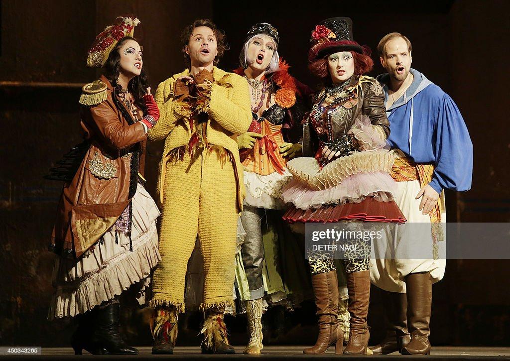 Alisa Kolosova Markus Werba as Papageno Christina Carvin Olga Bezsmertna and Benjamin Bruns as Tamino perform in a dress rehearsal of Wolfgang...